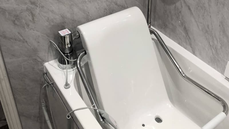Bath with seating and assisting controls