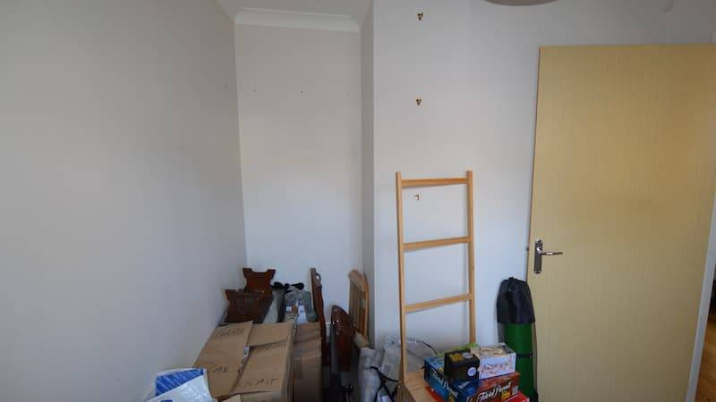 Plain room filled with various things no furniture