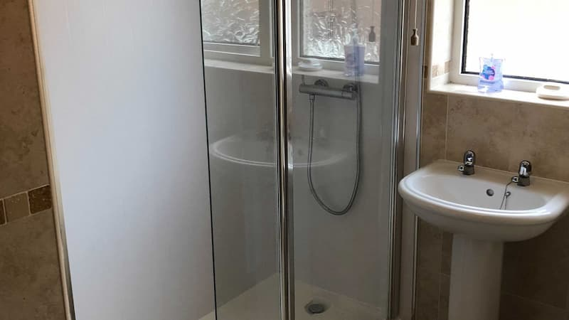 Walk in shower with glass slide door