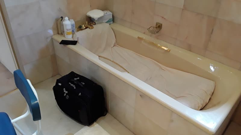Bath with sheets in it black bag on the side